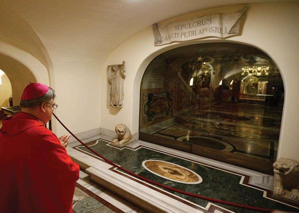 Bishop Schlert prays at St. Peter's Tomb