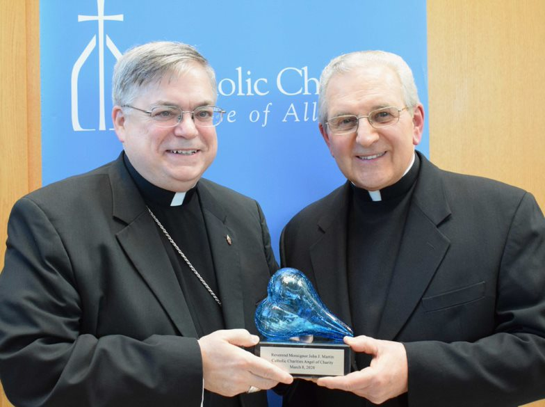 Gala honors three with charity of Christ in their hearts