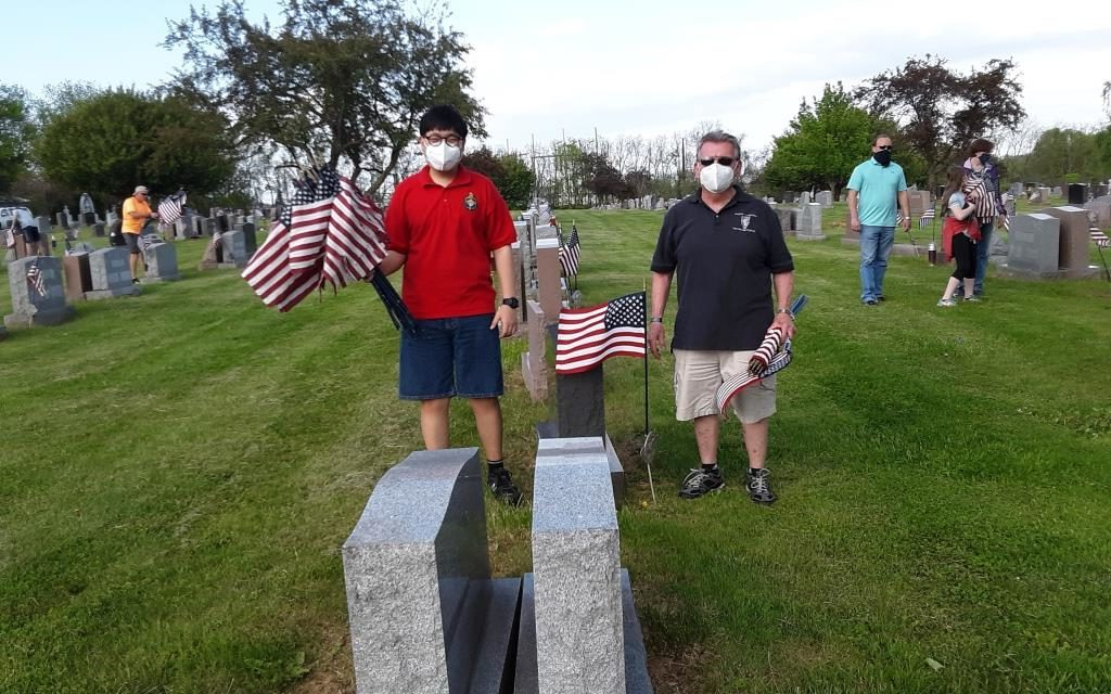 Knights, Scouts Team Up to Refresh Veterans' Flags Before Memorial Day