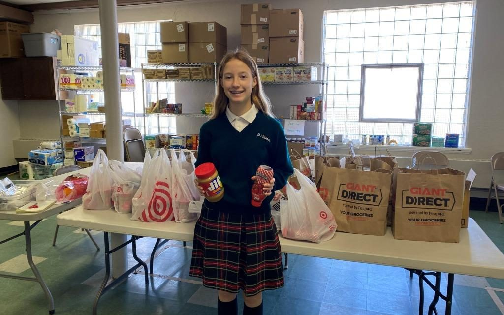 Eighth Grader Gives Up Birthday Gifts to Support Catholic Charities